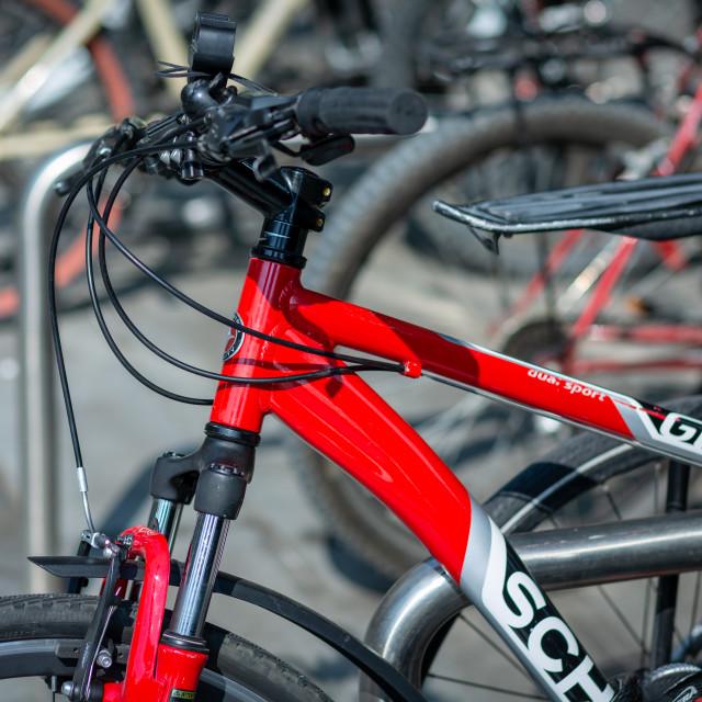 """""""Red bike on a bike rack"""" stock image"""