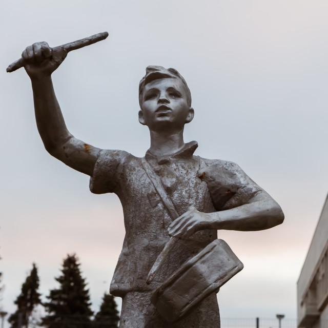 """November 2017, Ulyanovsk, Russia - statue of drummer boy, heritage of Vladimir Lenin All-Union Pioneer Organization, USSR propaganda"" stock image"