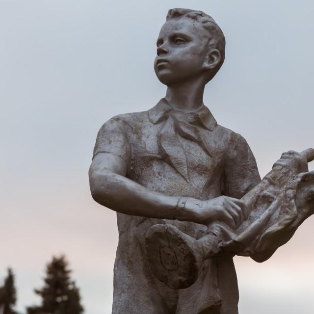 """November 2017, Ulyanovsk, Russia - statue of a boy, heritage of Vladimir Lenin All-Union Pioneer Organization, USSR propaganda"" stock image"