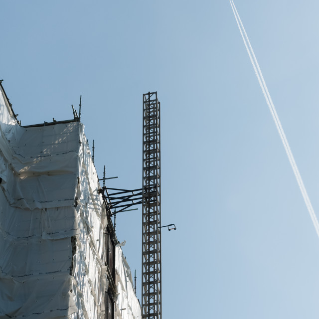 """""""skyscraper construction and aircraft contrail"""" stock image"""