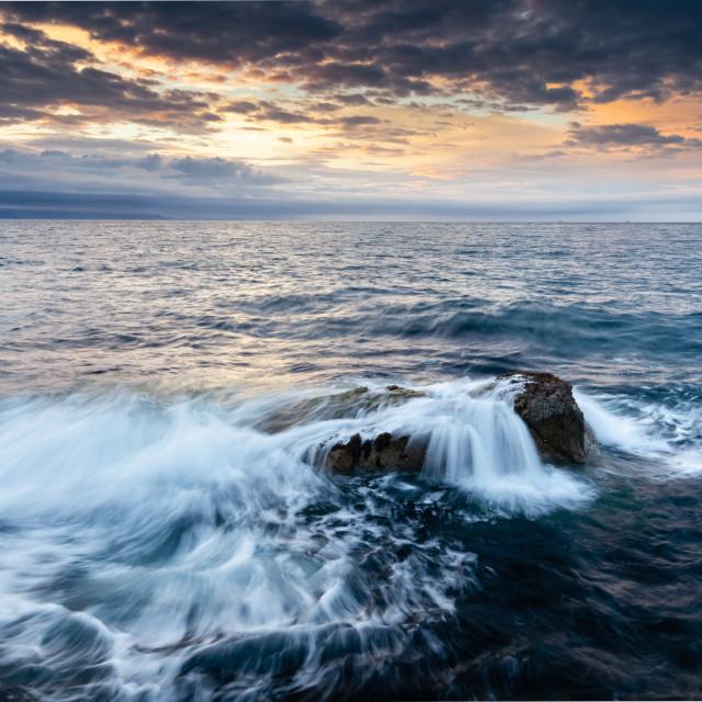 """Portmuck, Islandmagee, County Antrim, Northern Ireland: Sunset drama."" stock image"
