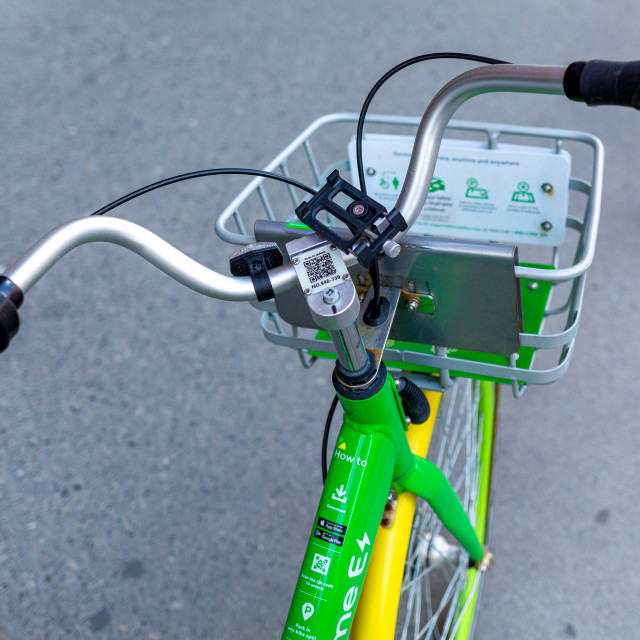 """E-Bike on a sidewalk"" stock image"