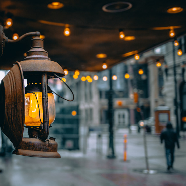 """Vintage lamp on a wall of a restaurant"" stock image"