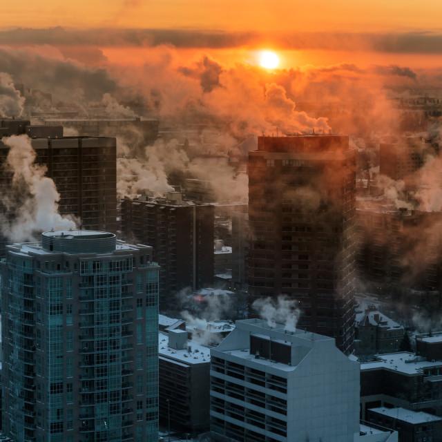 """Sunrise over a cityscape"" stock image"