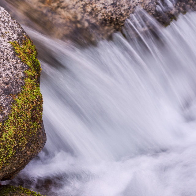 """Pure Spring Water Flowing Over Granite Rocks"" stock image"