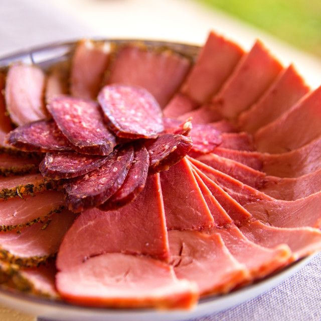 """""""Cold smoked meat plate with sliced prosciutto, salami, bacon, po"""" stock image"""