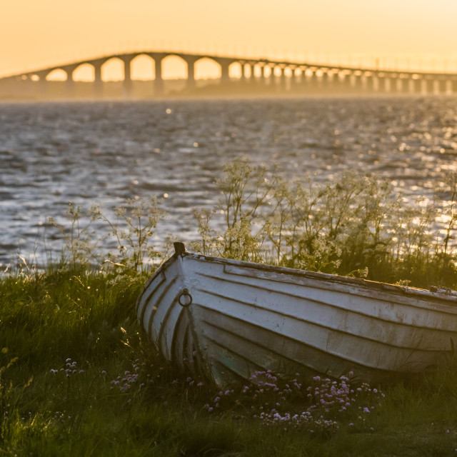 """The swedish Oland Bridge with an old rowing boat in the front"" stock image"