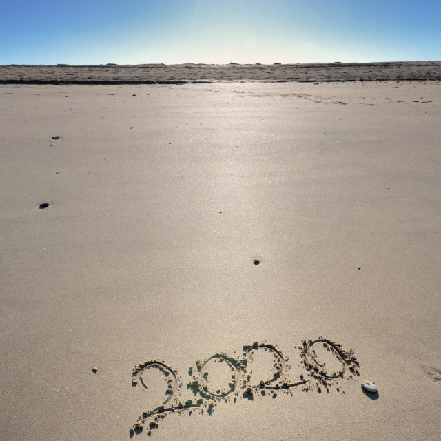 """""""2020 written on the sand under a beautiful sunny blue sky"""" stock image"""