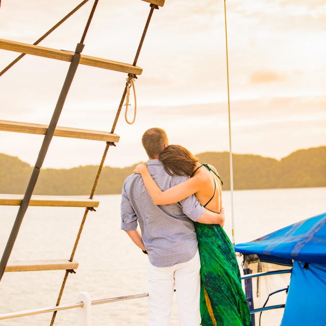 """""""Koror Island, Palau - couple enjoying the sunset on the Palau Siren"""" stock image"""