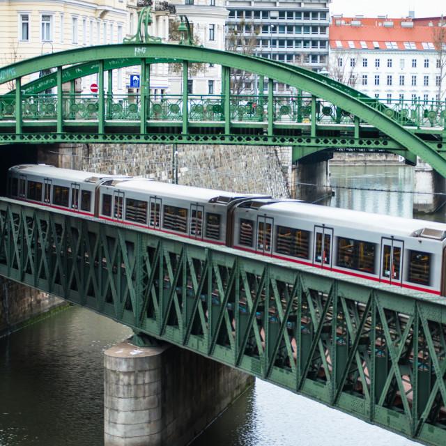 """""""U-Bahn train on Zollamtssteg Arch Bridge with Zollamtsbrücke Truss Bridge in..."""" stock image"""