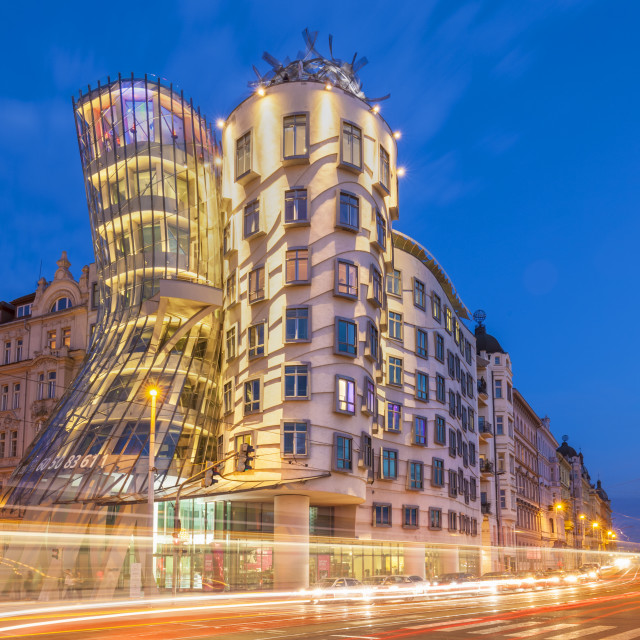 """""""Dancing House or Ginger and Fred at night by Frank Gehry, busy traffic light..."""" stock image"""
