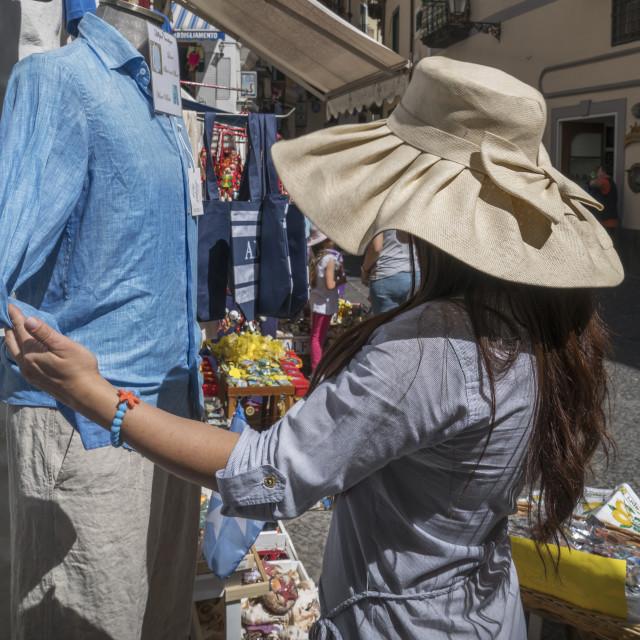 """Woman shopping in the streets of Amalfi, on the Amalfi Coast, Italy."" stock image"