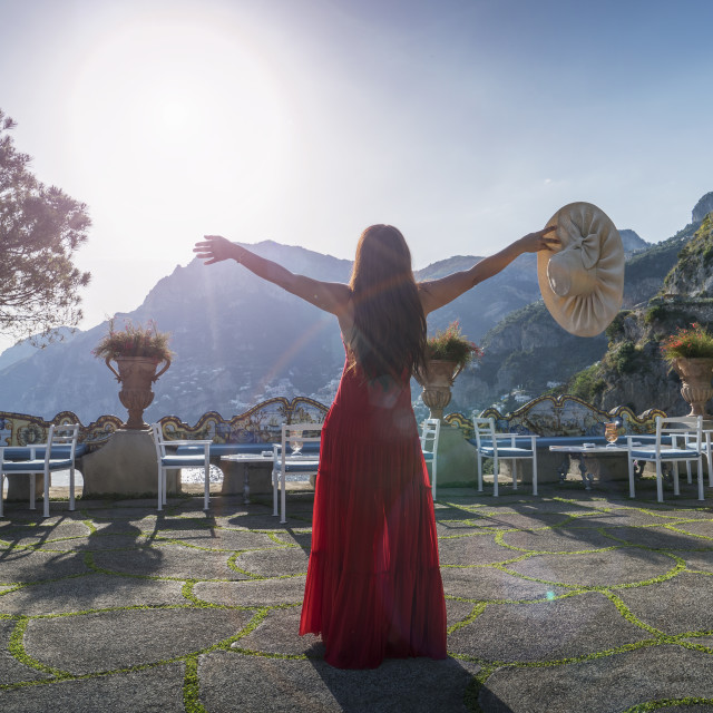 """""""Woman with red dress on the Amalfi Coast, Italy."""" stock image"""