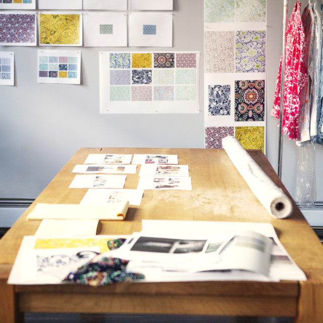 """""""Designs on wooden table in studio"""" stock image"""