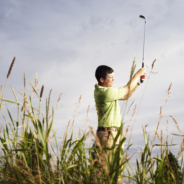 """Golfer watching his hit"" stock image"