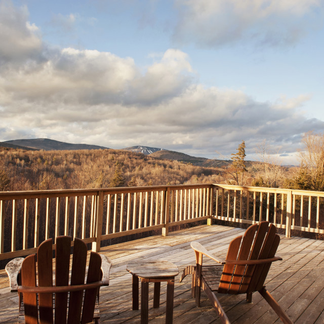 """""""Adirondack chairs at patio against mountains"""" stock image"""
