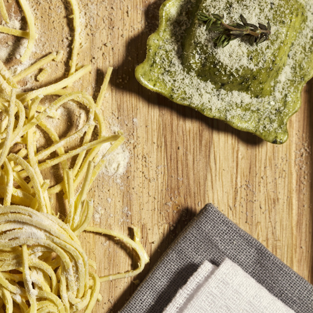 """""""Overhead view of pasta and ravioli on table"""" stock image"""