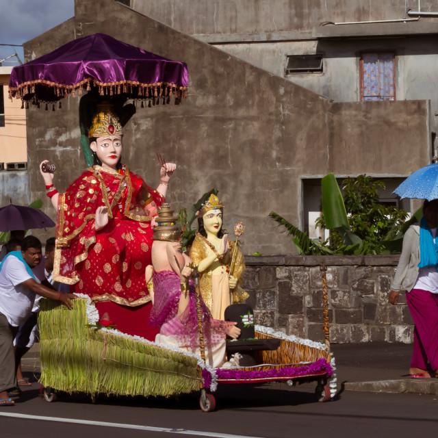 """Port Louis, Mauritius - February 11, 2018 - Men push a cart with decorated statue during celebrations of Hindu festival Maha Shivaratri (Great Night of Shiva)"" stock image"