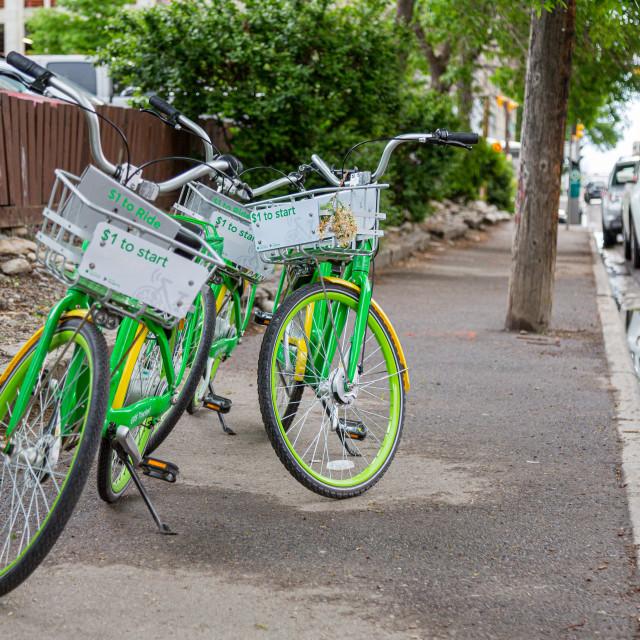"""E-Bikes on a sidewalk"" stock image"