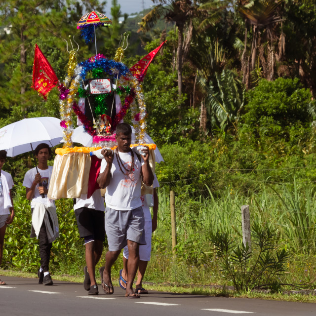 """Port Louis, Mauritius - February 11, 2018 - Men carry a decorated platform during celebrations of Hindu festival Maha Shivaratri (Great Night of Shiva)"" stock image"