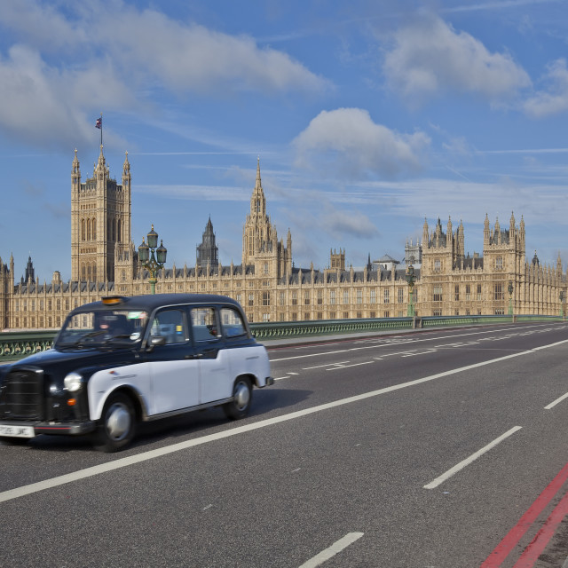 """Parliament of London and a taxi on the Westminster Bridge."" stock image"