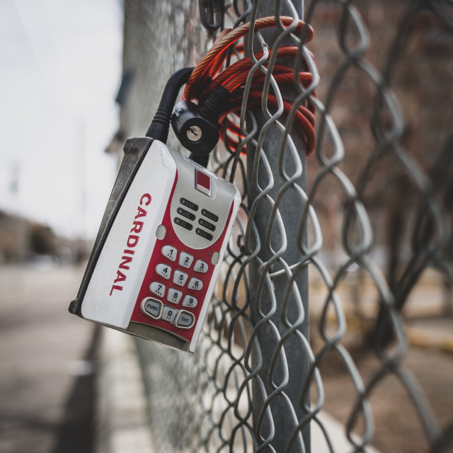 """Real estate lock box on a fence"" stock image"