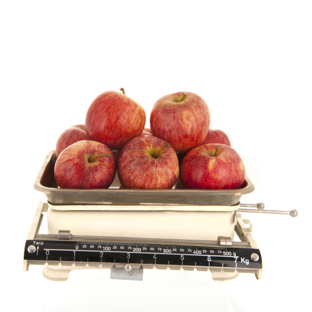 """""""weight scale fresh apples isolated over white background"""" stock image"""