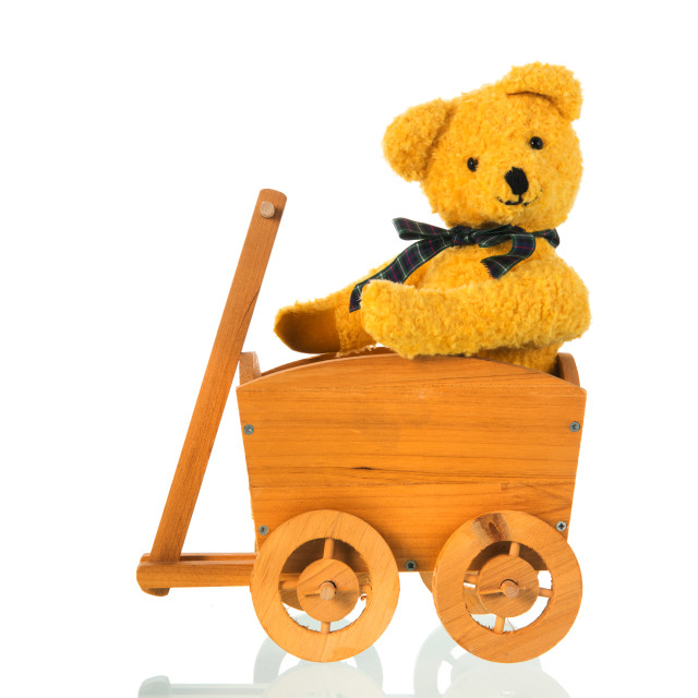 """""""Stuffed toy bear with bow in cart"""" stock image"""