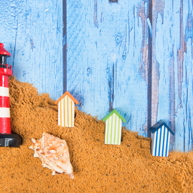 """""""Lighthouse and beach huts in sand"""" stock image"""