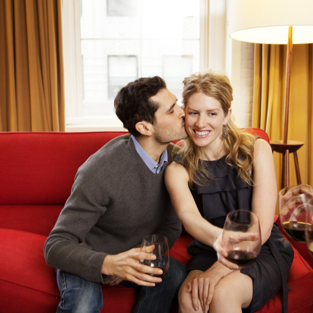 """""""Couple Kissing On Couch"""" stock image"""