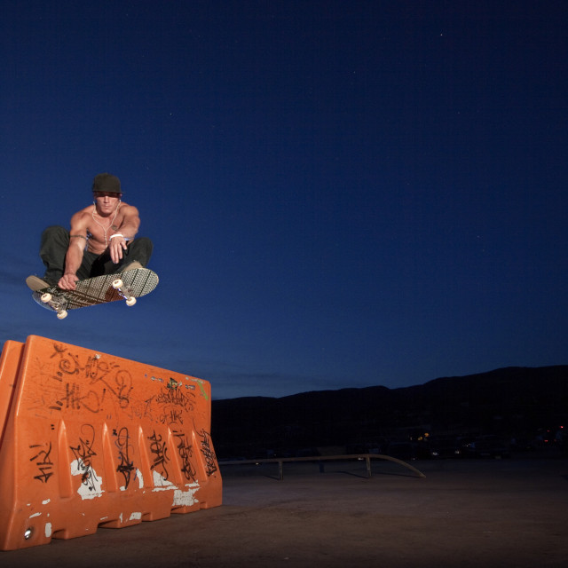 """skateboarder doing a frontside grab"" stock image"