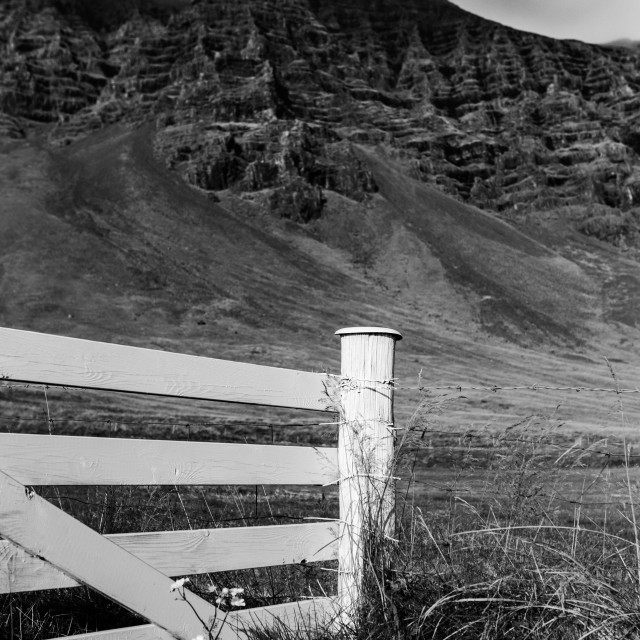 """""""White Picket Fence with Volcanic Hills Beyond in Iceland"""" stock image"""