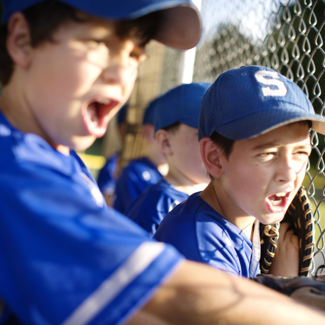 """""""Little League Players Cheering from the Dugout"""" stock image"""