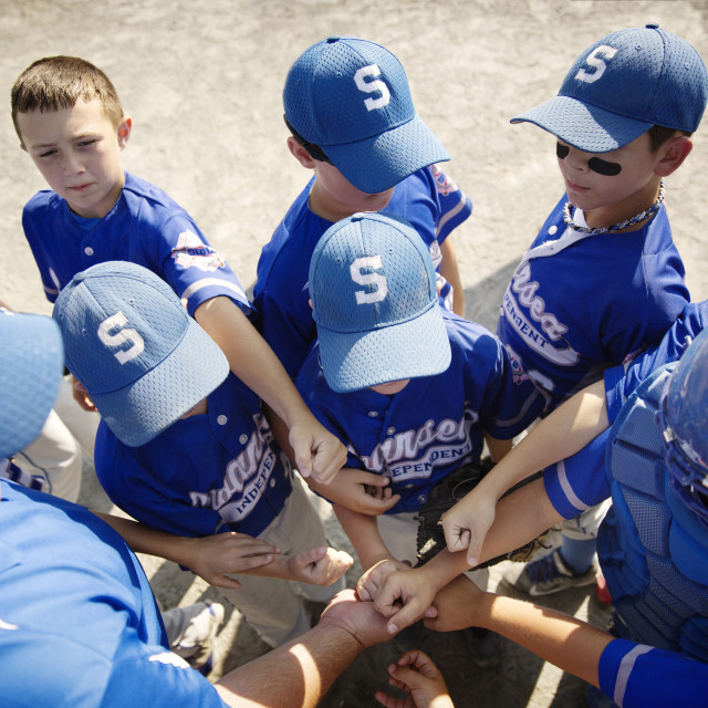 """""""Little League Players Having Pep Talk with Coach"""" stock image"""