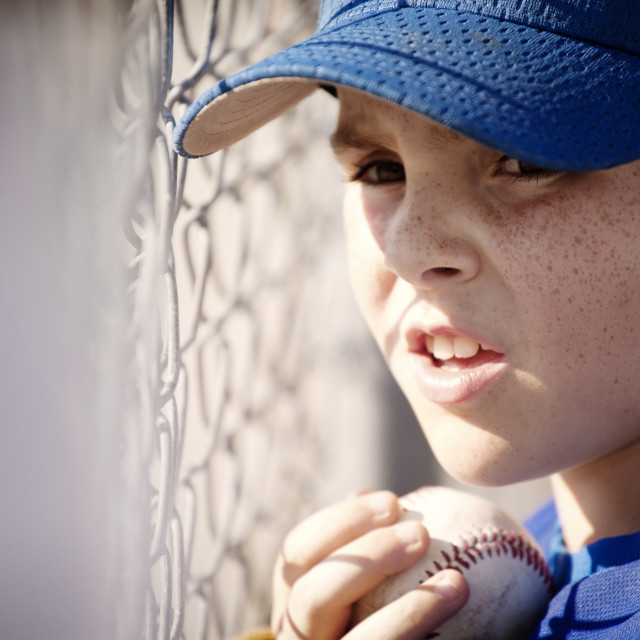 """""""Little League Player Watching Game from Dugout"""" stock image"""