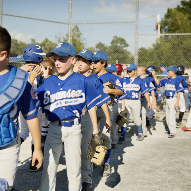 """""""Little League Teams Congratulating After Game"""" stock image"""