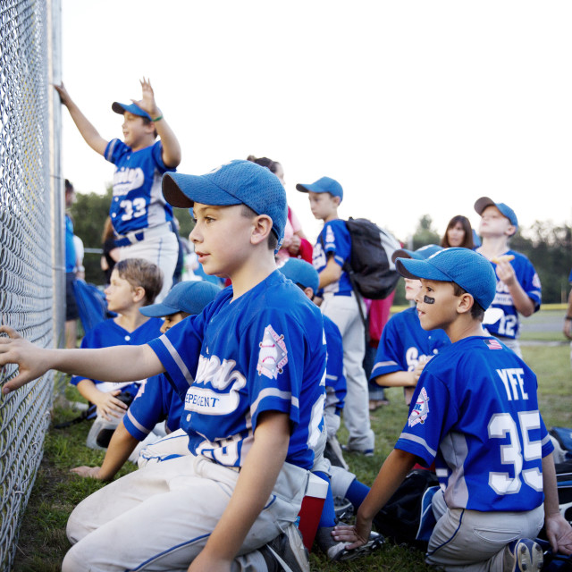 """""""Little League Team Cheering from Behind Fence"""" stock image"""