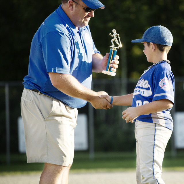 """""""Coach Presenting Trophy to Little League Player"""" stock image"""