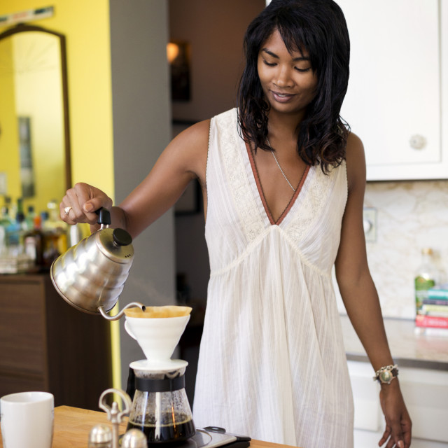 """""""Woman pouring water in coffee pot"""" stock image"""