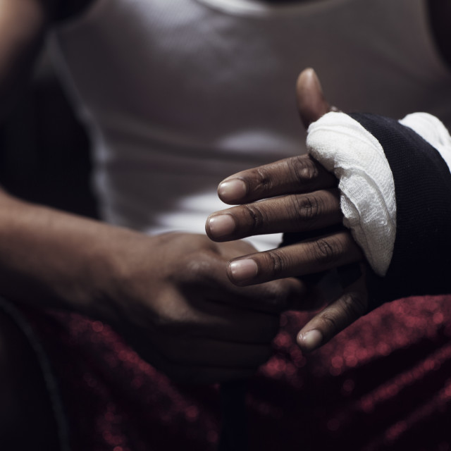 """Man wrapping hands in gym"" stock image"