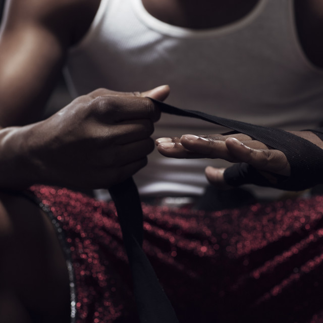 """Midsection of man wrapping hands gym"" stock image"