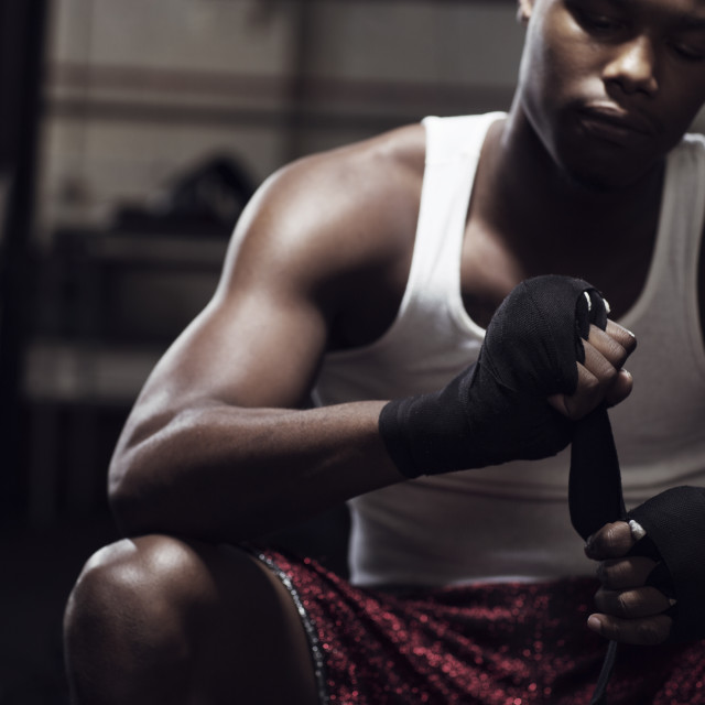 """Man preparing for boxing in gym"" stock image"