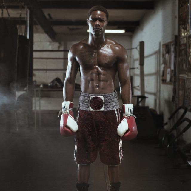 """""""Full length of boxer standing in gym"""" stock image"""
