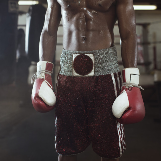 """""""Midsection of boxer standing in gym"""" stock image"""