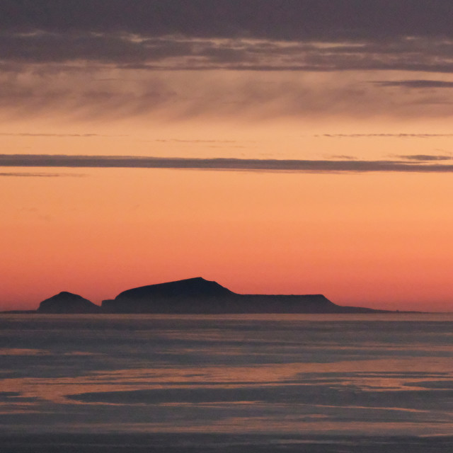 """Sunset Behind Foula, Shetland."" stock image"