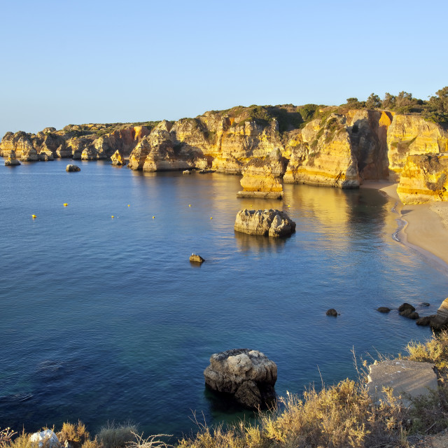 """Praia Dona Ana at sunrise, Lagos, Algarve, Portugal"" stock image"