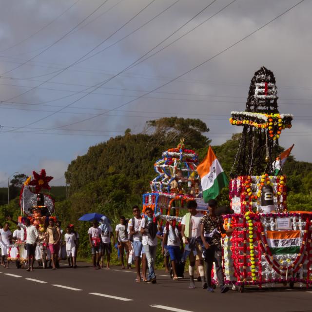 """Port Louis, Mauritius - February 11, 2018 - Men pull a decorated cart during celebrations of Hindu festival Maha Shivaratri (Great Night of Shiva)"" stock image"
