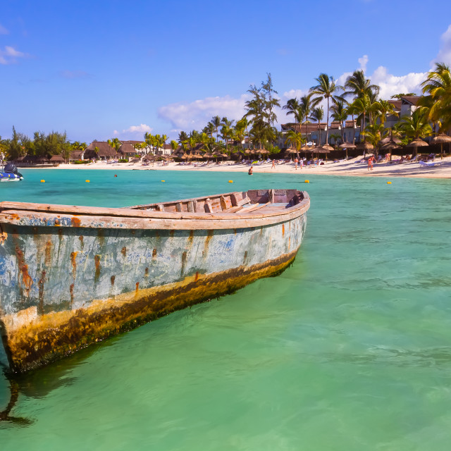 """""""An old fisherman boat moored near beach on tropical island of Mauritius"""" stock image"""