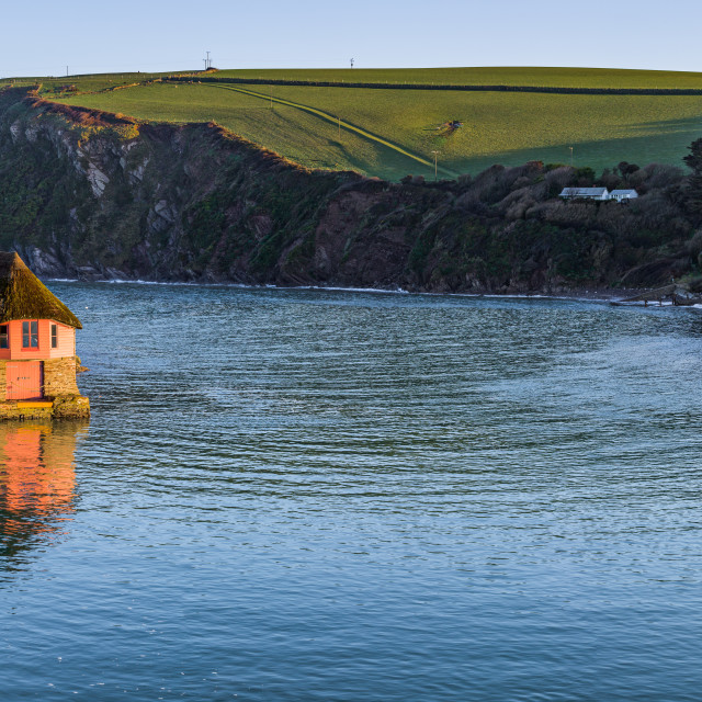 """Boathouse on the banks"" stock image"