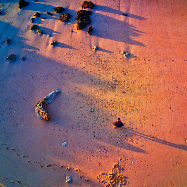 """""""AERIAL VIEW OF A MEN ALONE ON THE BEACH"""" stock image"""